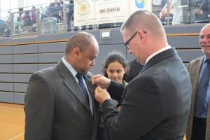 Michael Gust awarding Dr. Tsegaye Degineh - Saaron Degineh