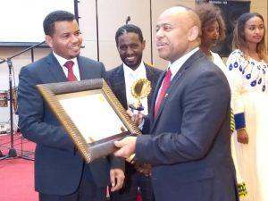 Addis Ababa Acting Mayor Takele Uma Awarding Dr. Tsegaye Degineh, 2019
